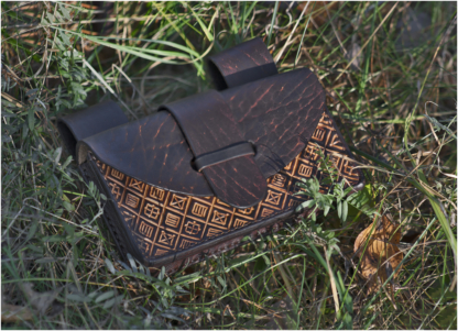 Dark brown leather belt pouch with pattern