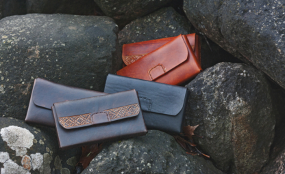Leather belt pouches in various colors.