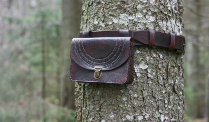 Leather belt bag with carvings.