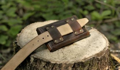 Leather belt loops on the belt bag's back side