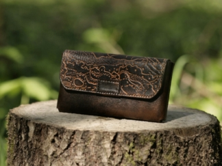 Leather belt bag with magnet lock, decorated by hand carved orienteering map