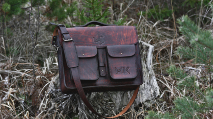 Dark brown leather briefcase with many pockets in various sizes