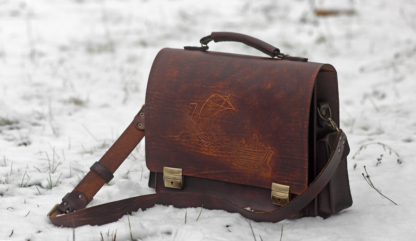 Leather briefcase with carving from Estonian mythology
