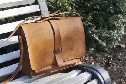 Leather briefcase with four pockets