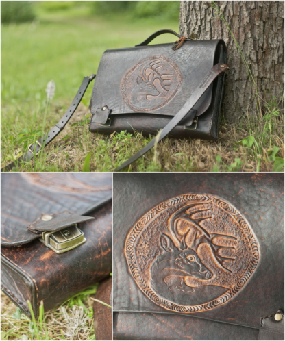 Leather briefcase with a deer