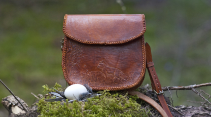 Leather handbag with carved fox