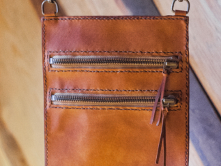 Brown leather neck wallet with zippers