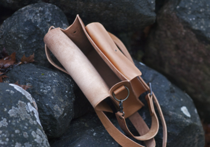 Leather shoulder bag with three pockets