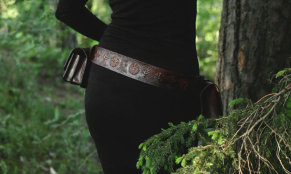 Belt and belt bags are decorated by hand carved archaic symbols that depict trees and wood.