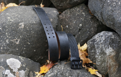 Black leather belt with two- pronged buckle