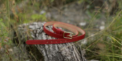 Narrow red leather belt for women