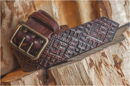 Wide leather belt with old swastika pattern