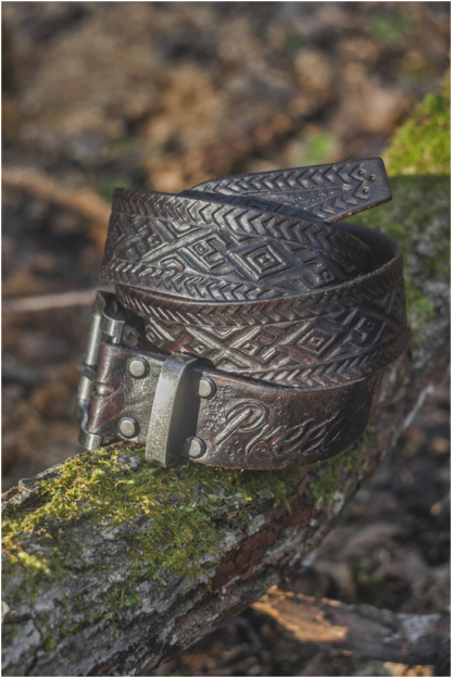 Leather belt with hand carved folk pattern
