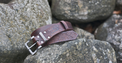 Carved leather belt in mahogany