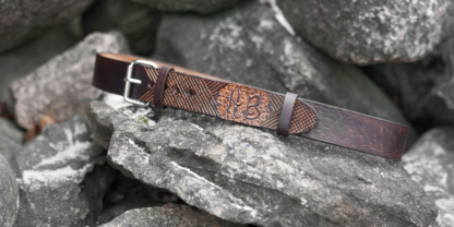 Leather belt with hand carved pattern and initials