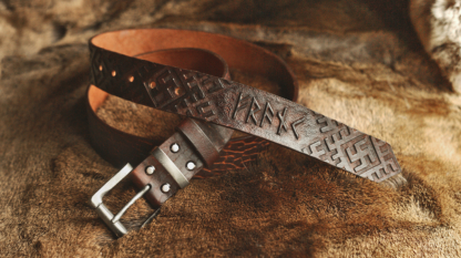 Leather belt with carved runic script and pattern