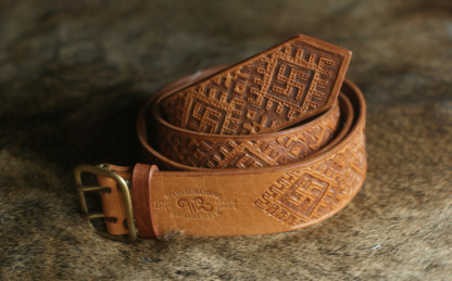 Leather belt with swastika pattern