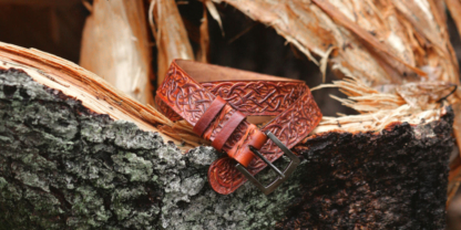 Carved brown leather belt