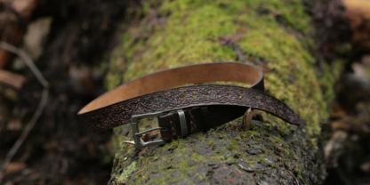 Dark brown carved leather belt