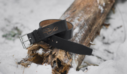 Black leather belt with carved feather image.