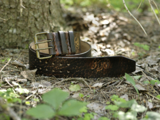 Dark brown leather belt with carved ram image