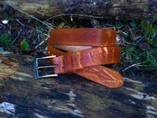 Brown leather belt with carved rune and spearhead
