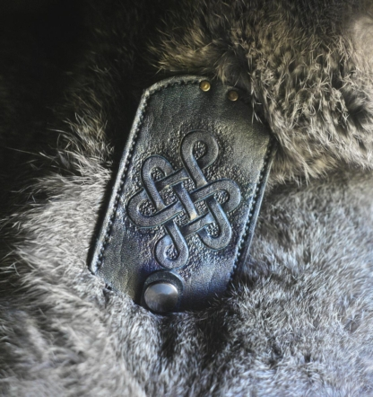 Leather key case with endless knot