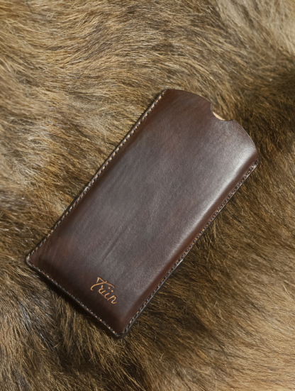 Leather phone sleeve with hand carved name