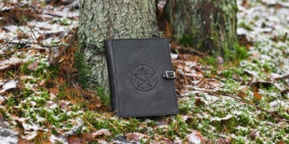 Leather covers with carved pentagram