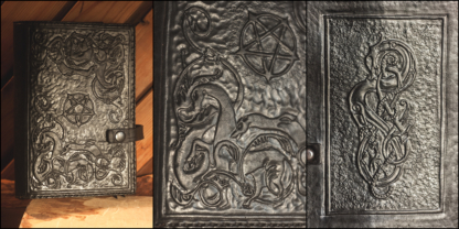 Leather notebook covers with Urnes style carvings