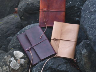 Notebook covers with a strap