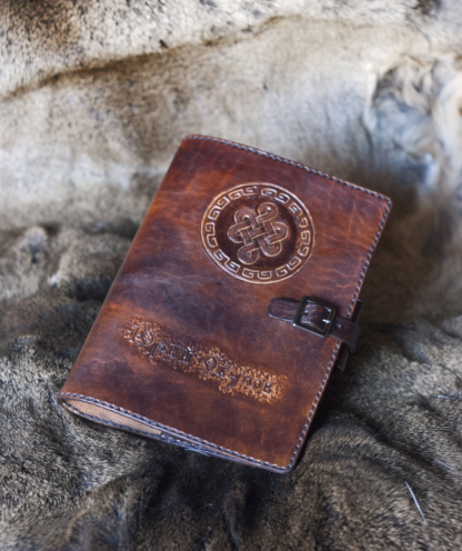 Leather notebook covers with hand carved Endless knot sign.