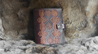 Leather notebook covers with hand carved folk pattern from Viljandi, Estonia