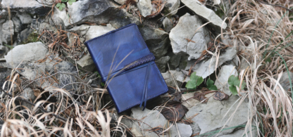 Blue leather notebook covers with strap tie down