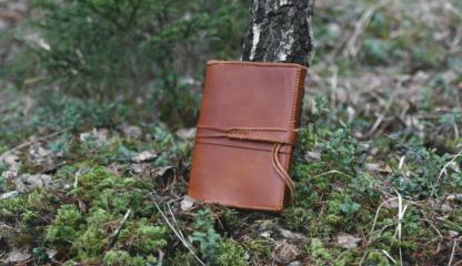 Light brown leather notebook covers with strap tie down