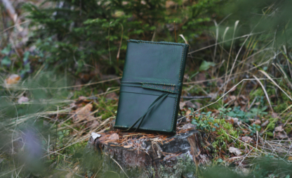 Green leather notebook covers with strap tie down