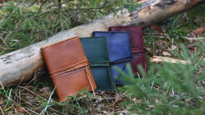 Leather notebook covers with strap tie down