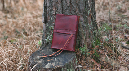 Red leather notebook covers with strap tie down