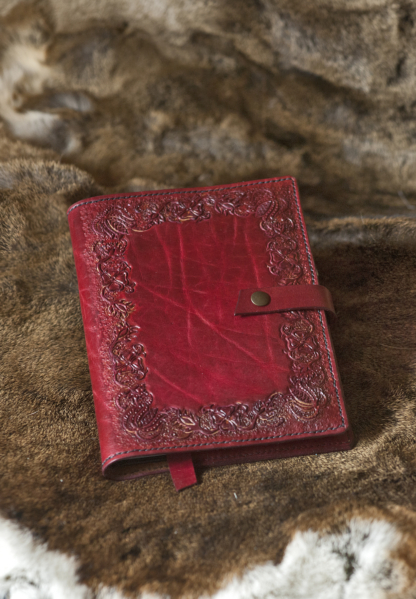 Red leather notebook covers with hand carved floral pattern