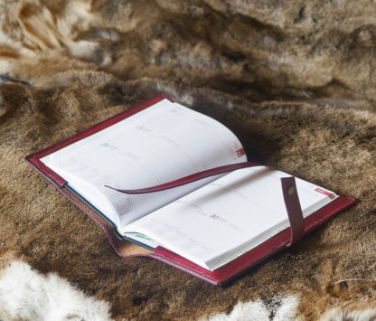 Red leather notebook covers with hand carved floral pattern, inside