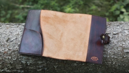 Dark brown notebook covers with carved name