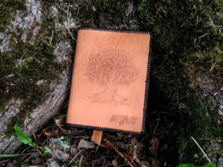 Leather notebook covers with an oak tree