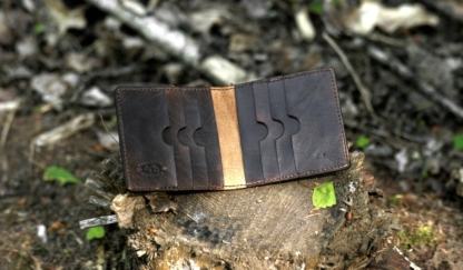 Dark brown carved leather card case with eight pockets.
