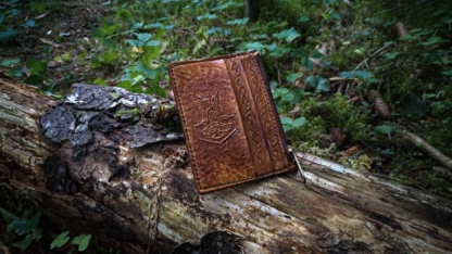 Leather card case with five pockets, decorated by hand carved viking image