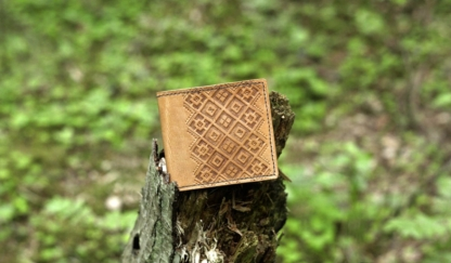 Hand carved leather card wallet. Oiled finish.