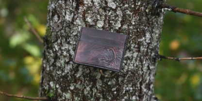 Leather card case with scorpion image