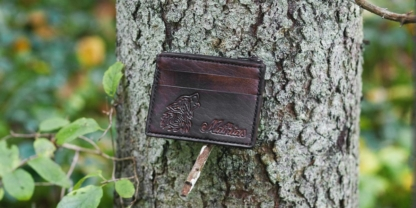 Leather card case with wolf image