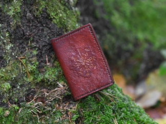 Leather card case, decorated by runes