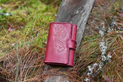 Red leather women's wallet with laced edges and phoenix