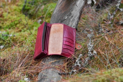 Red leather women's wallet with laced edges and phoenix, inside